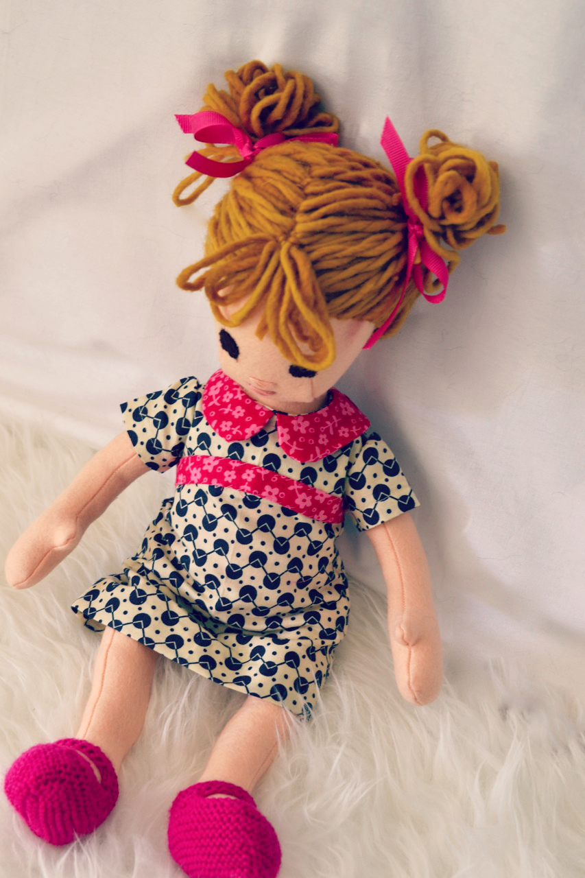 Handmade doll with pigtails