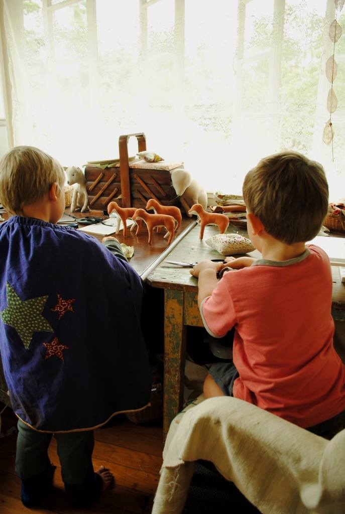 Her boys sewing in the studio