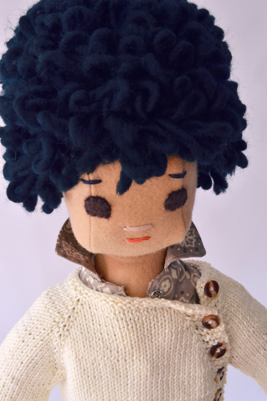 Boy doll with handknit sweater