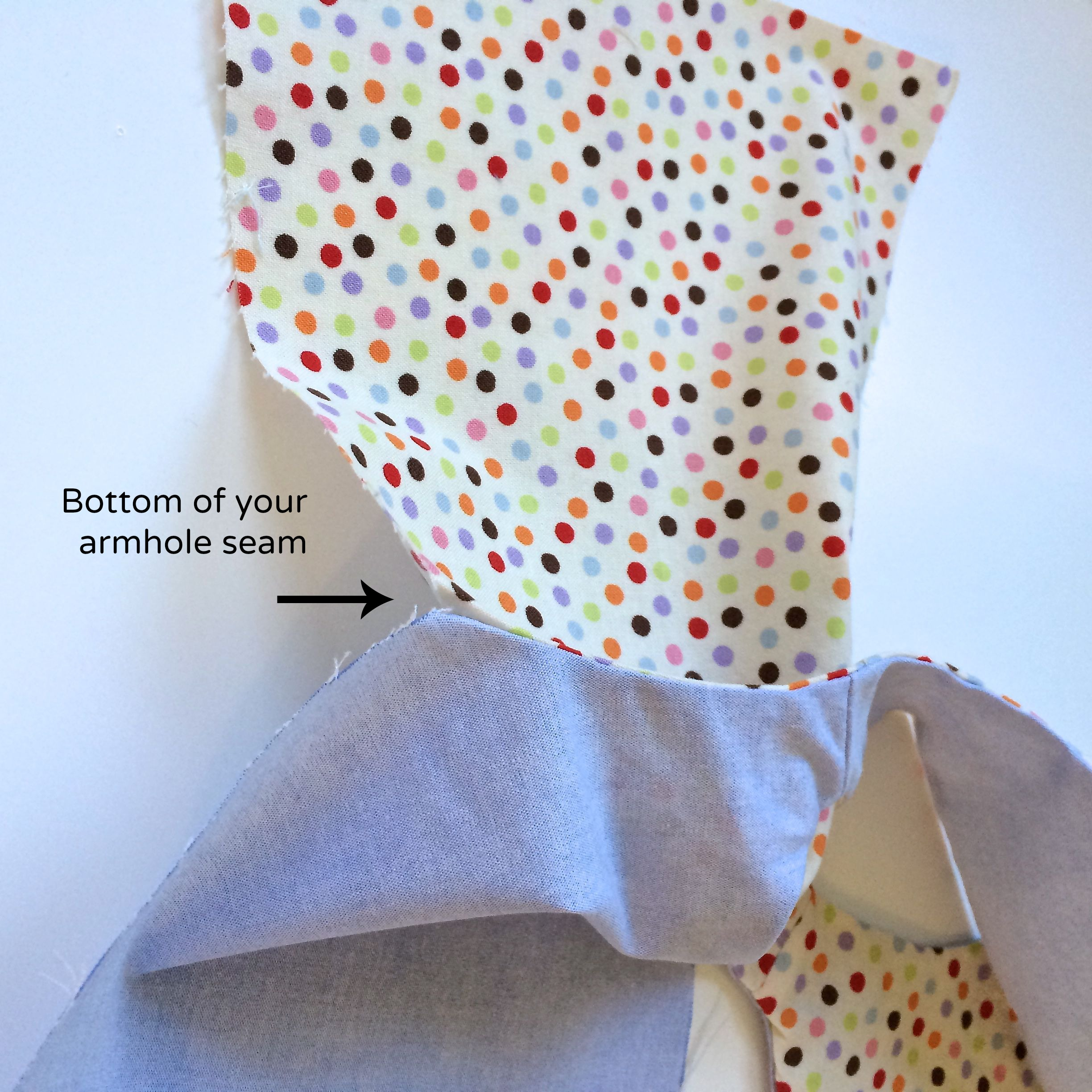 Match bottom of your armhole seams.