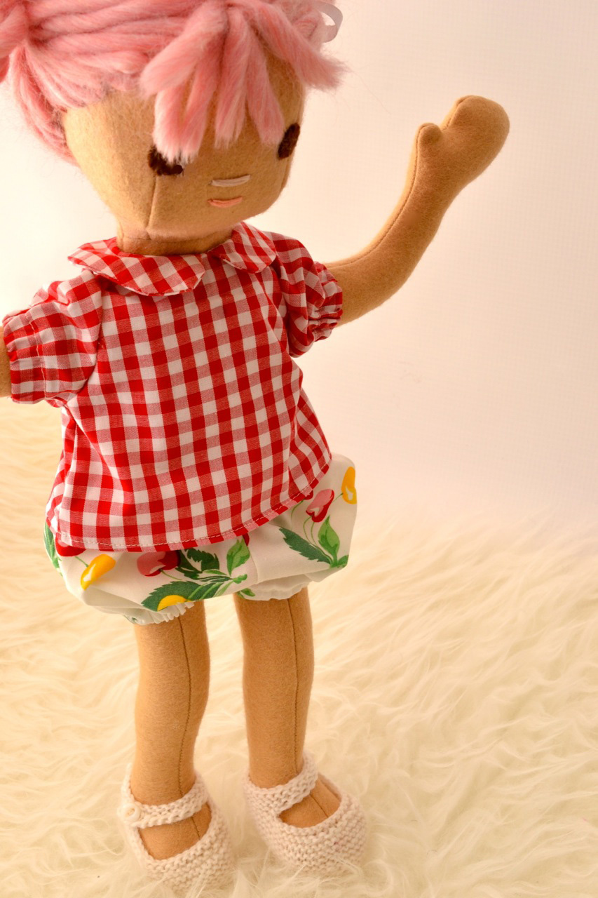 A custom Baby Egg in her retro cherries and gingham outfit