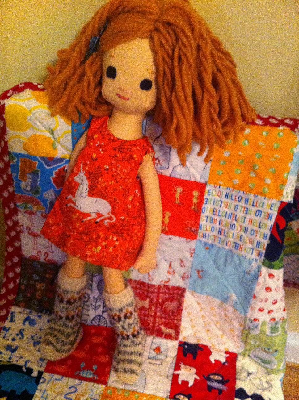 Phoebe models handmade boots, quilt and a unicorn dress.