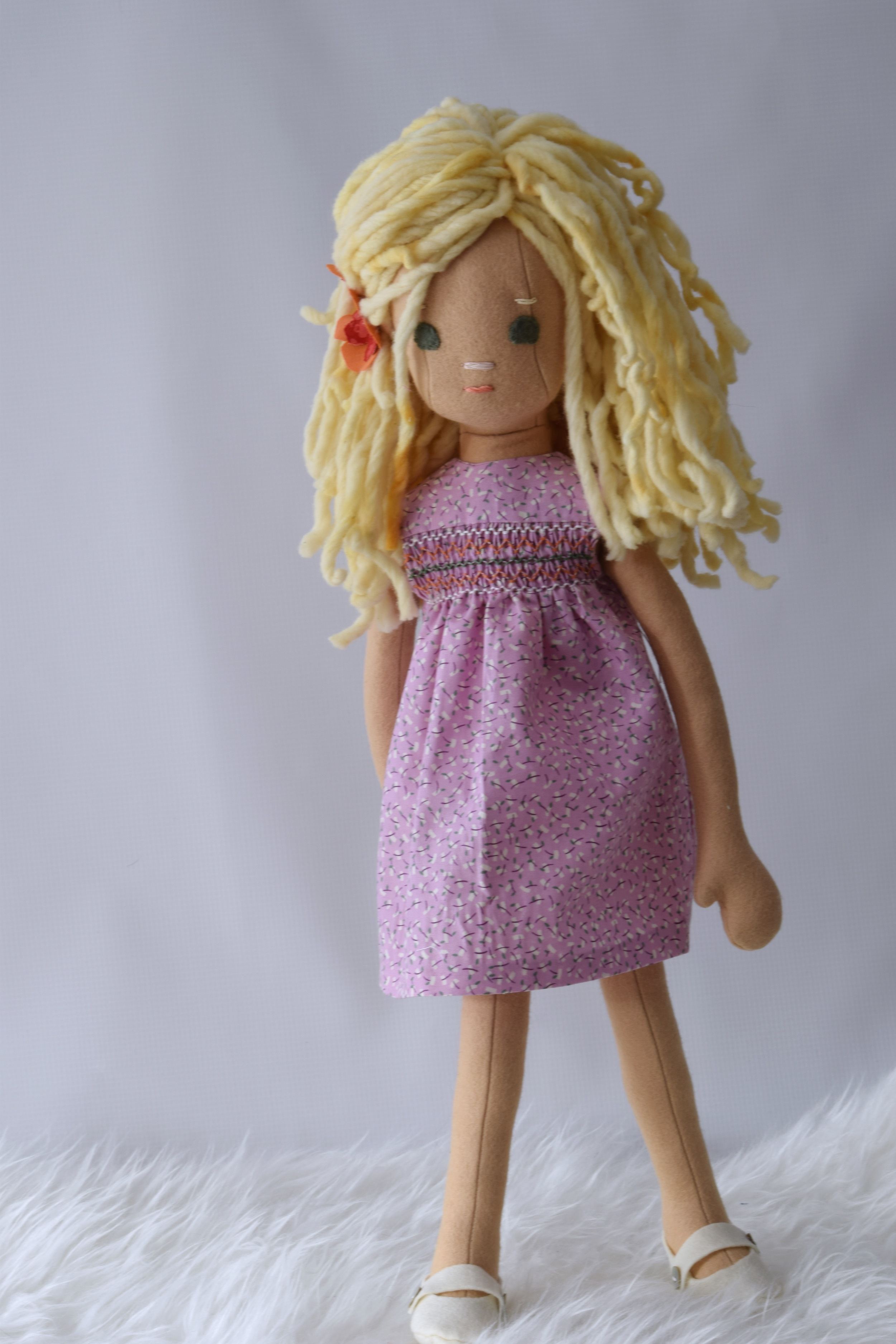 Handmade doll with smocked dress