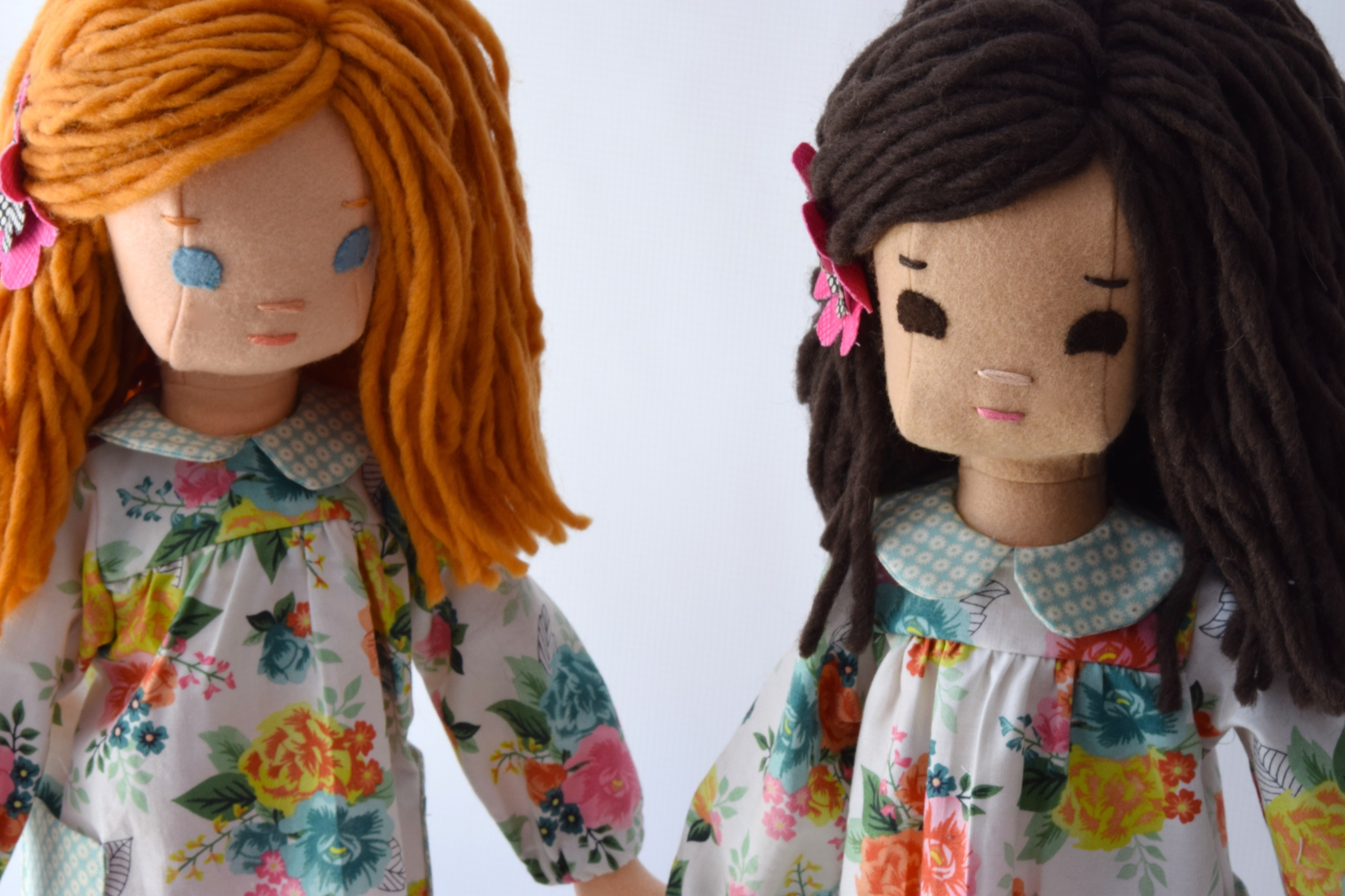 Two dolls with their spring dresses