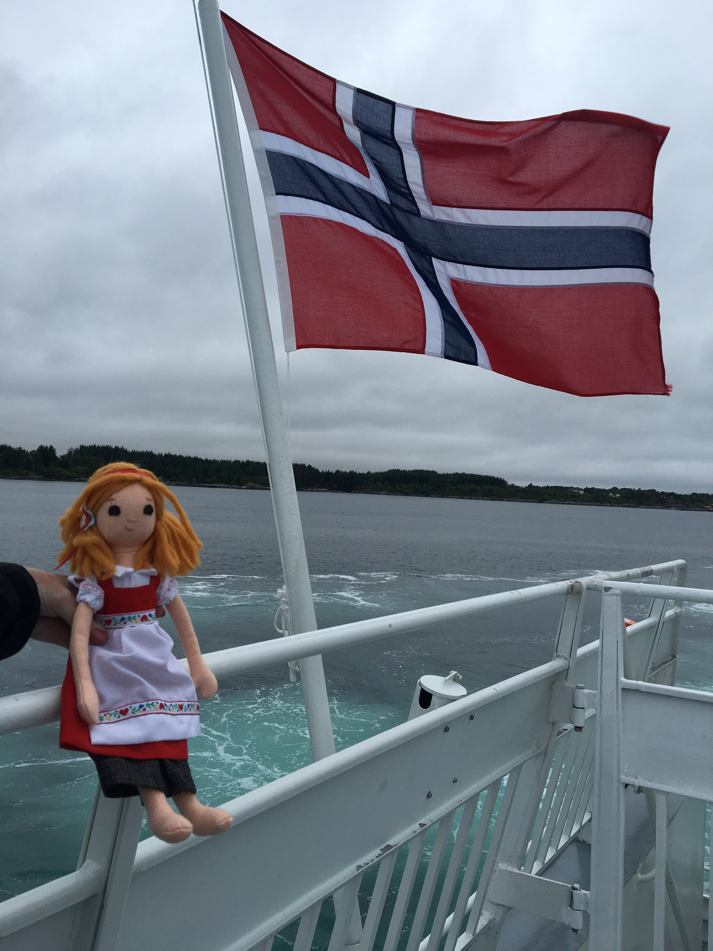 Phoebe travels by boat in Norway
