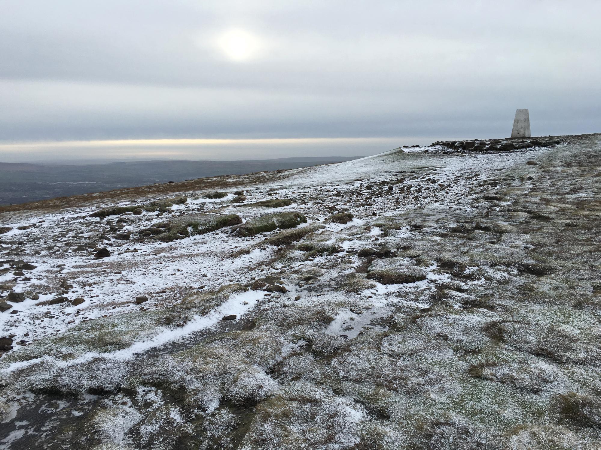 A frozen Pendle summit.