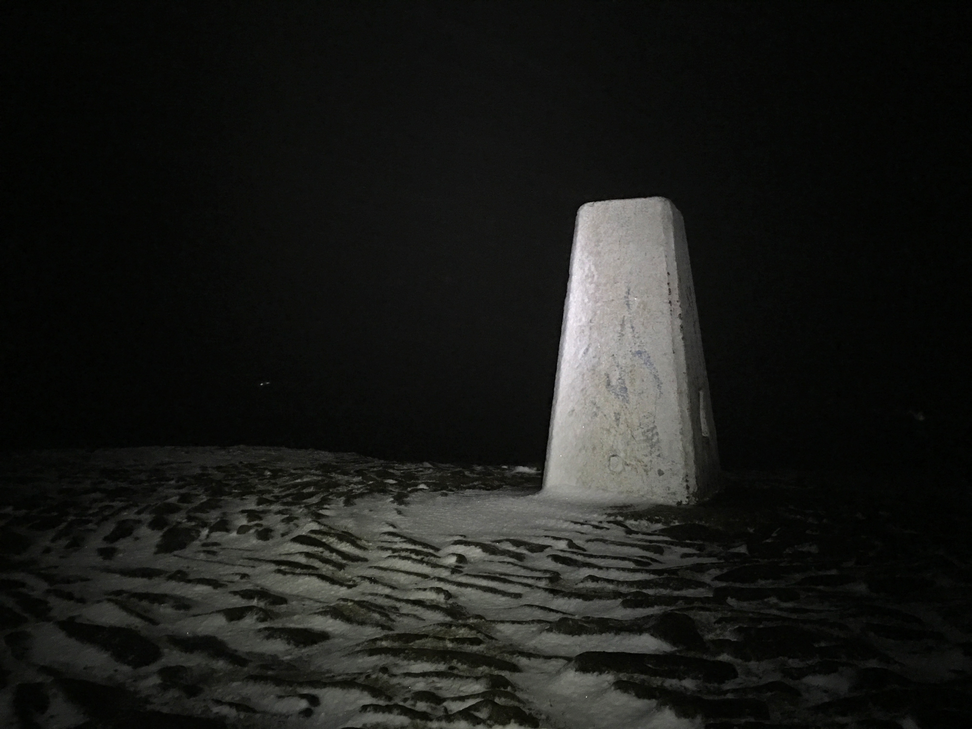 Darkness at Pendle trig point.