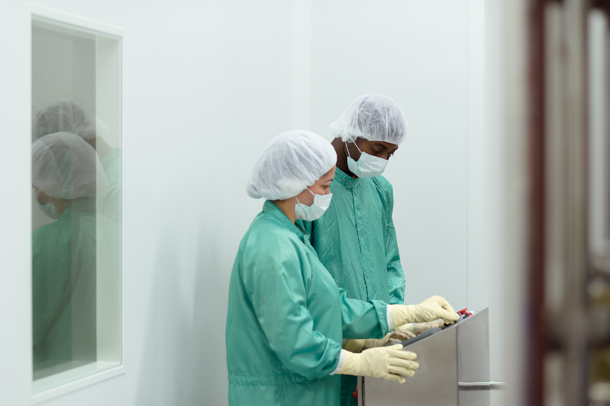011656965_staff and researchers checking equipment in biotech industry.jpeg
