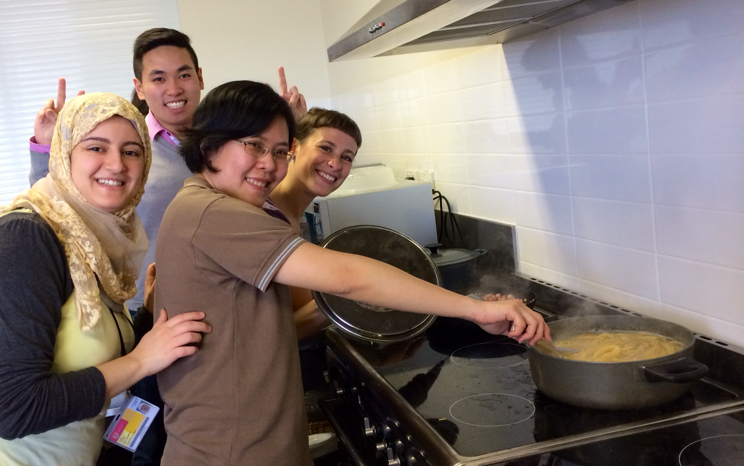 How many people does it take to stir the pasta.JPG