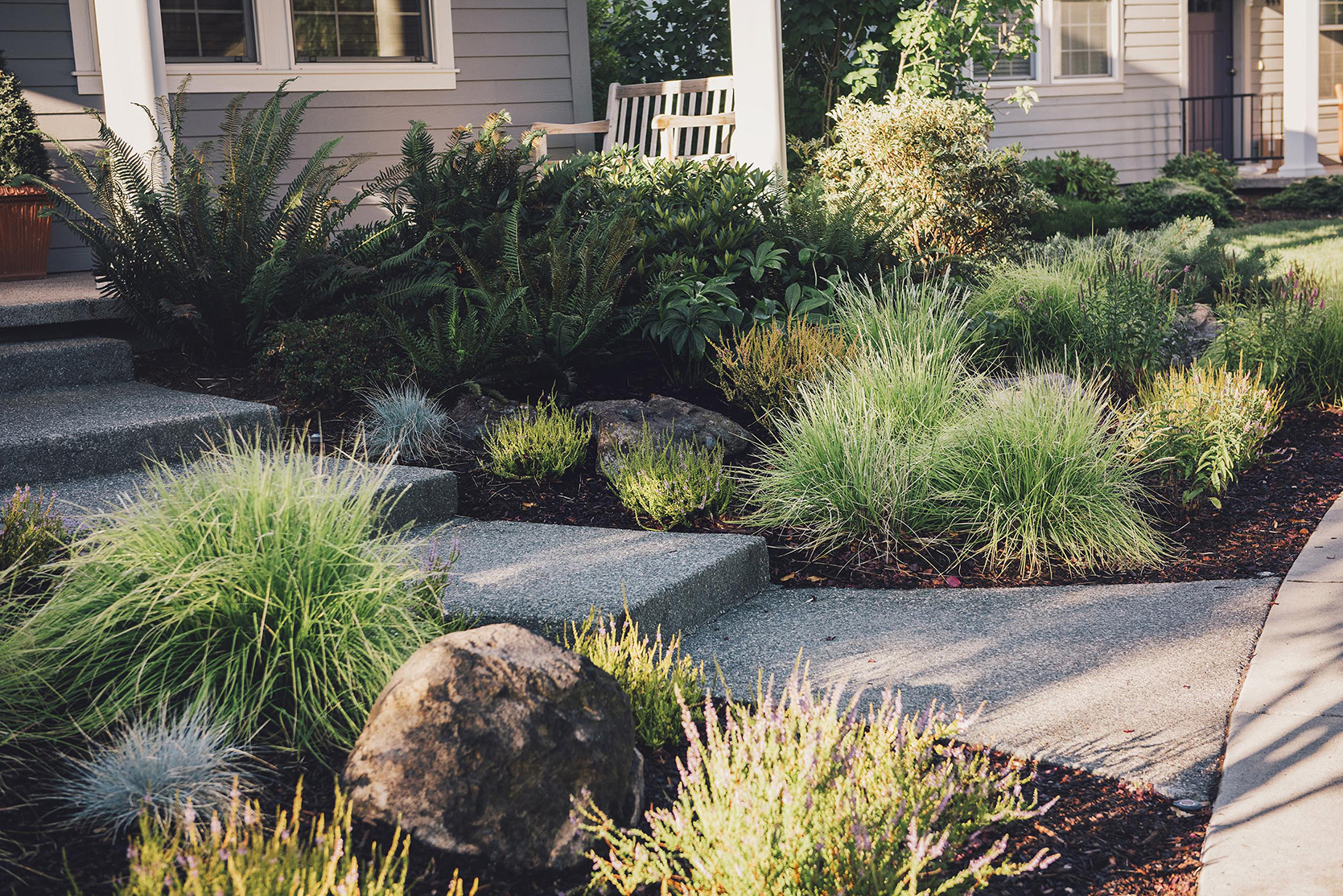 placed granite boulders + curbside appeal + perennial low maitenance PNW garden