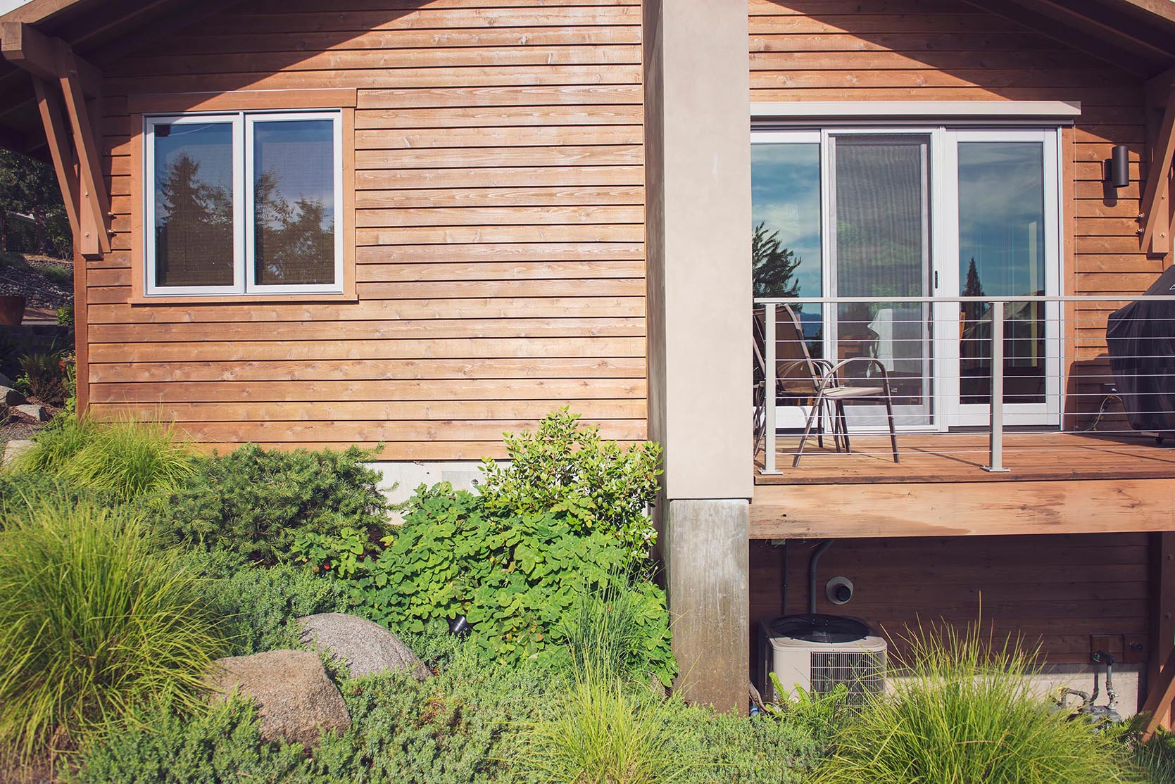 lush deer resistant perennial gardening + modern pacific northwest garden + granite boulders