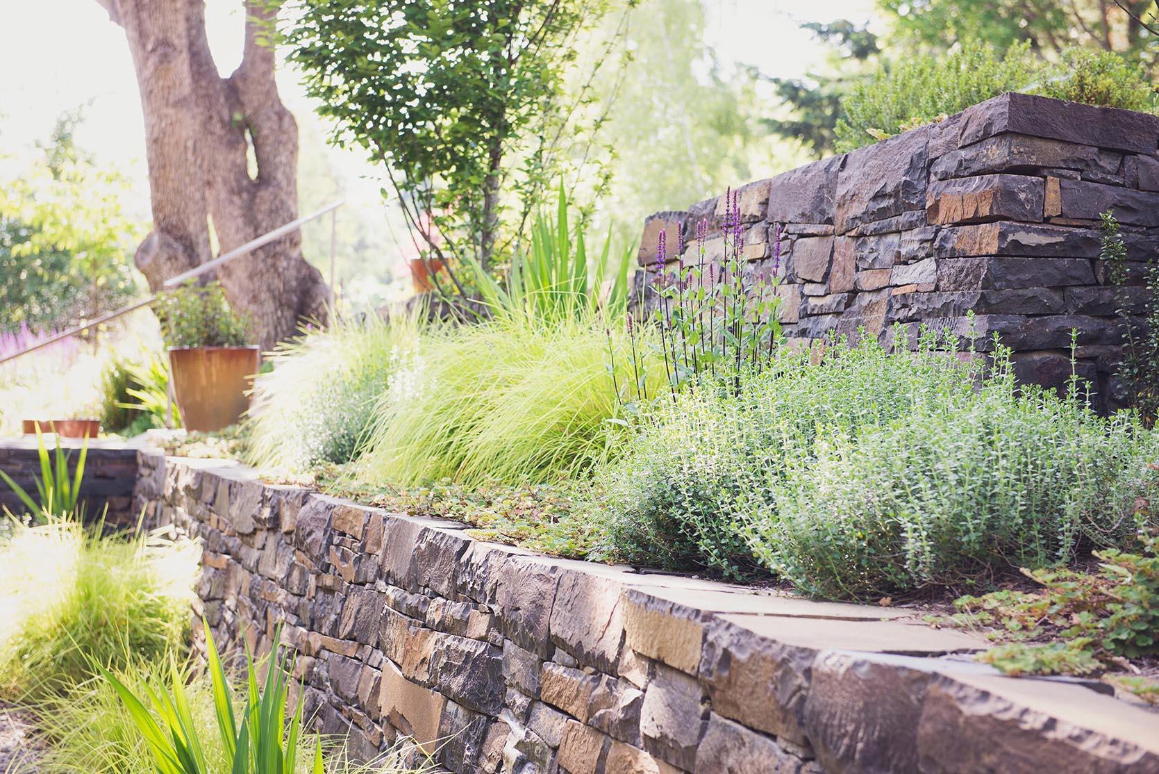 Stacked Basalt Rock retaining Wall + local materials + deer resistant perennial garden + terraced perennial beds