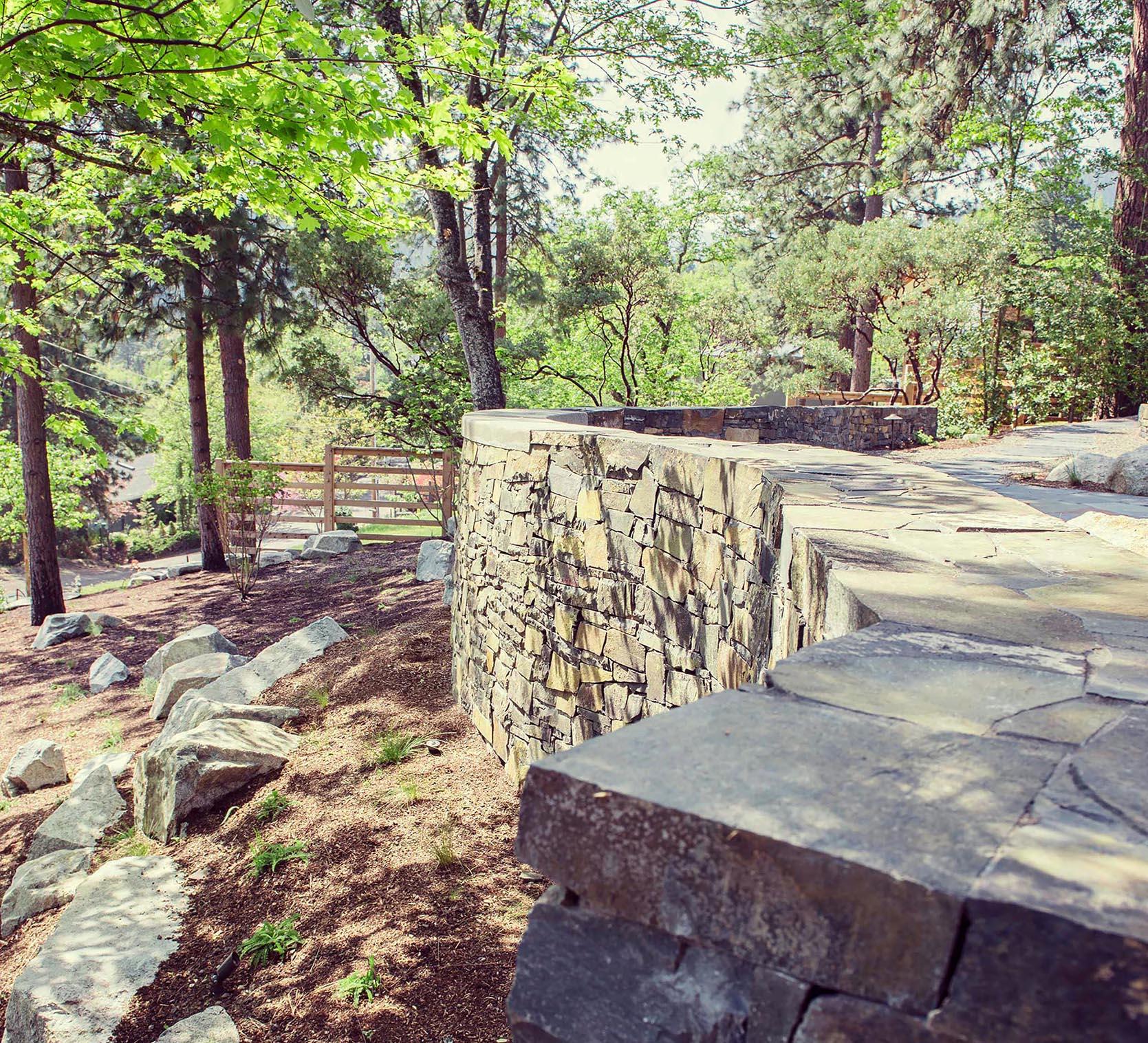 Basalt Retaining Wall + Granite Bounders + Hillside slope