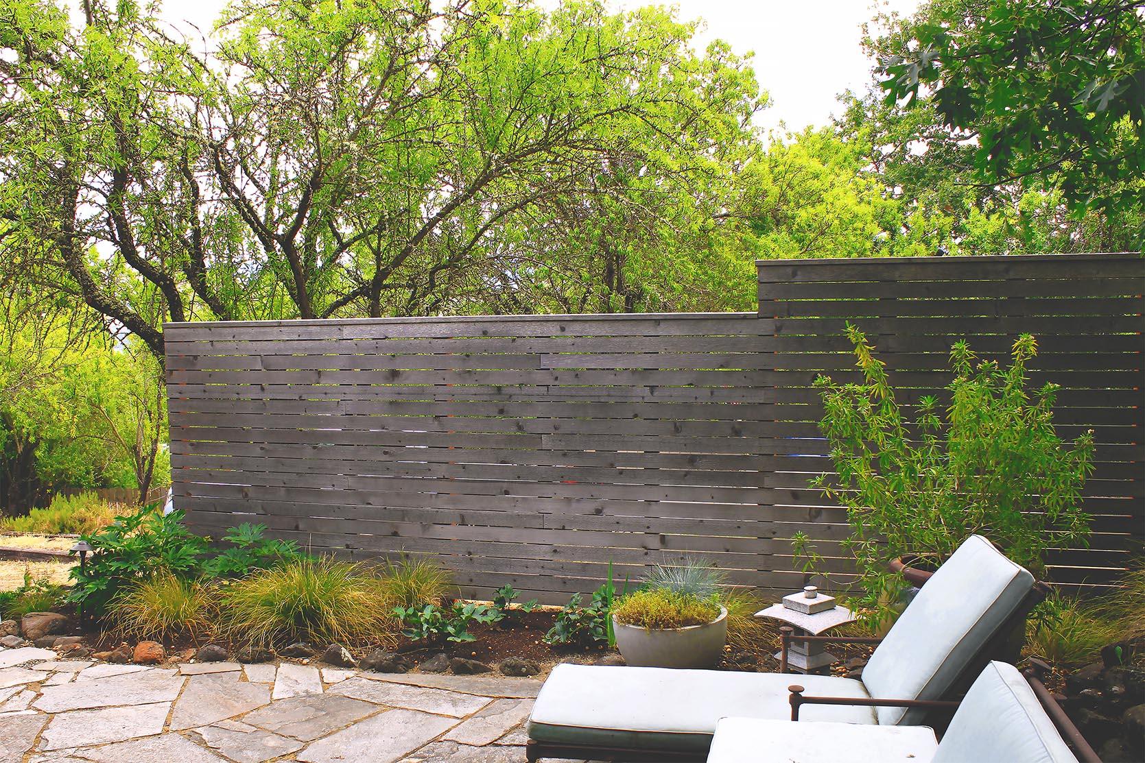 Flagstone Patio + Path + Timber + Gravel Steps + Horizontal Cedar Slat Privacy Fence + Deer-Resistant Perennial Garden + Modern + Seating Area
