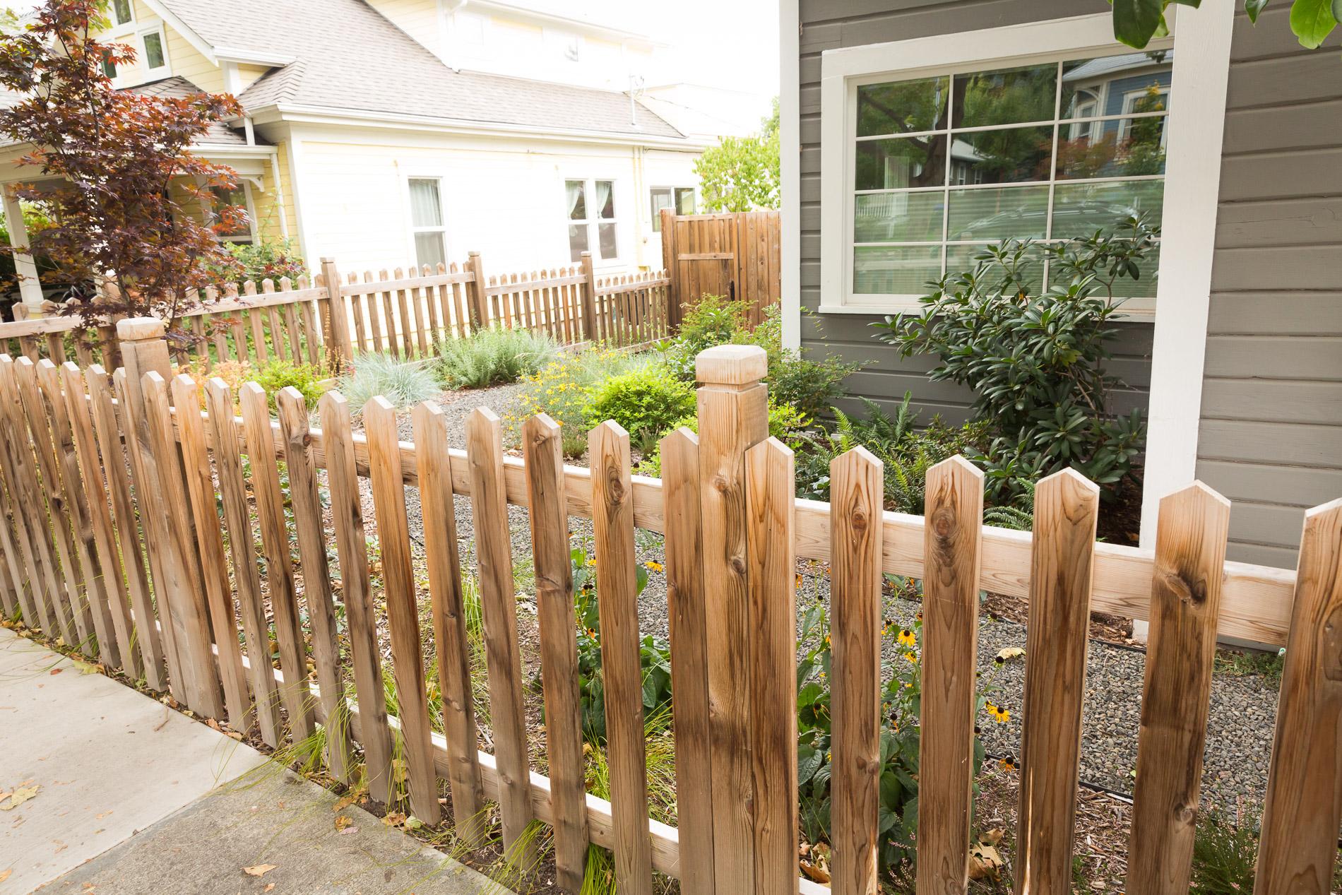 Closed Picket Cedar Fence + Perennial Garden + Gravel Path