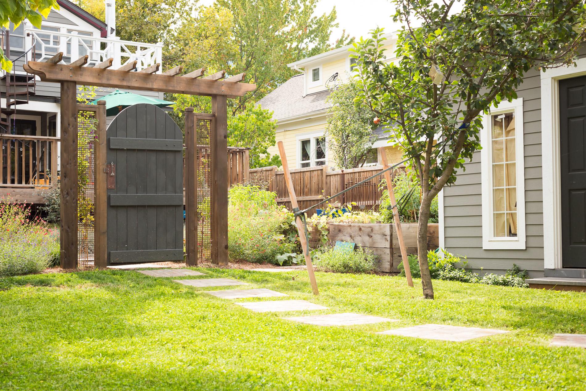 Ornamental Gate Arbor + segmented brick pathway + Eco-Lawn