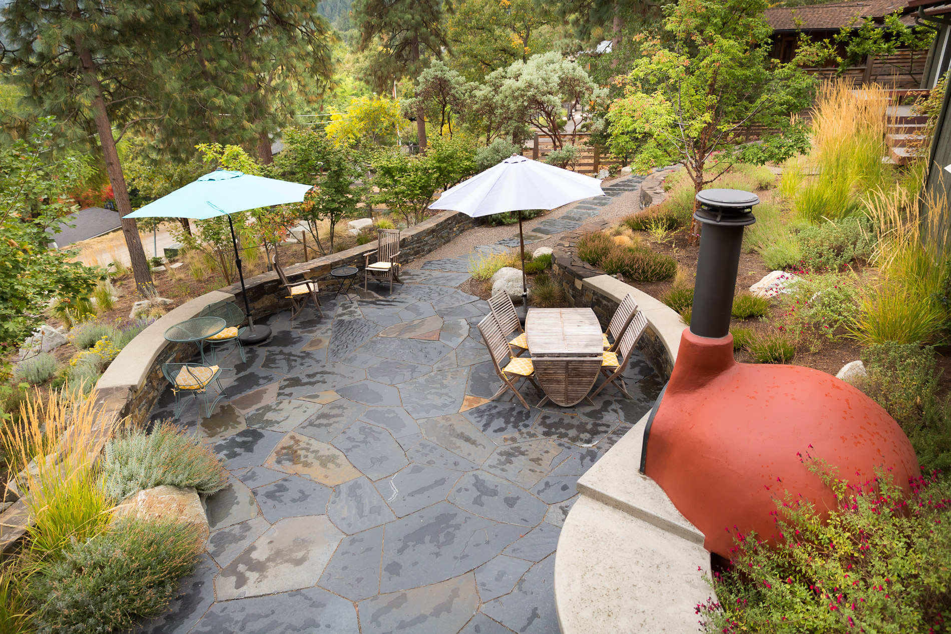 Flagstone Dining Patio + Overlook + Curved conrete + stacked rock walls