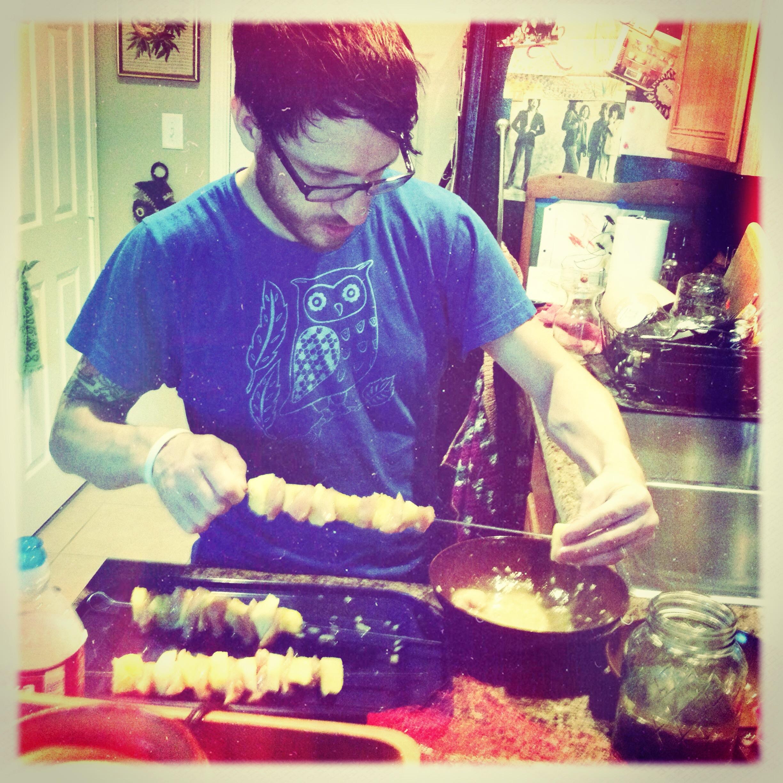 james making chicken pineapple cabobs.JPG