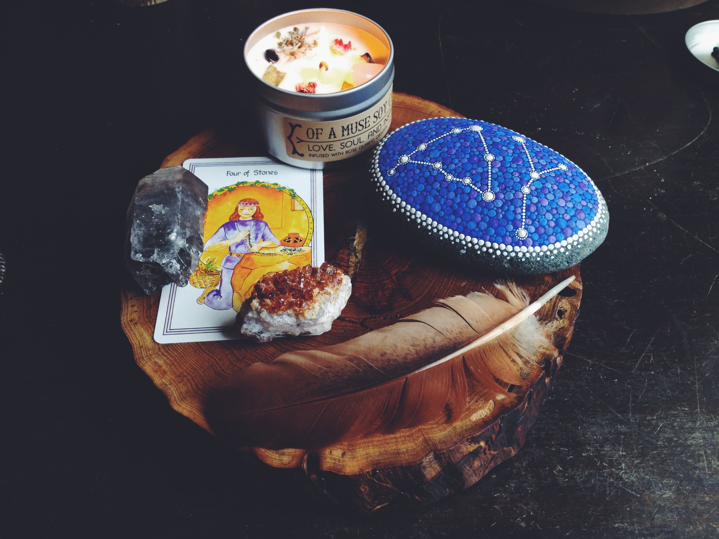 My card for the month of February, Handmade candle made by  House of Good Ju Ju  for a local shop called  Of A Muse , Handpainted zodiac stone for James and I by  Elspeth McLean , reclaimed wood oak slice by  Nature Bound .