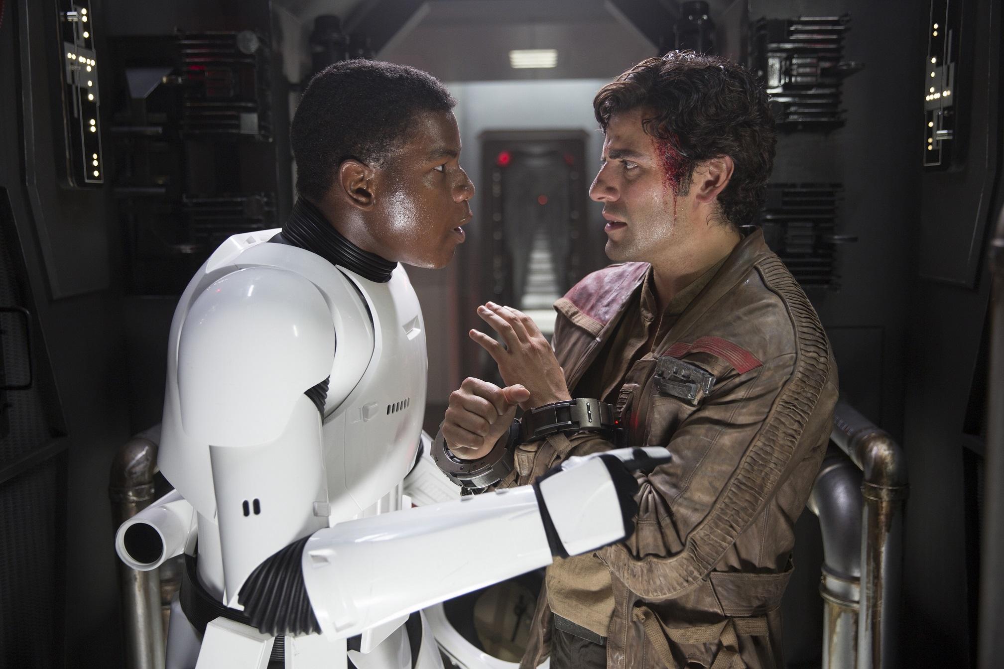 Star Wars: The Force Awakens..L to R: Finn (John Boyega) and Poe Dameron (Oscar Isaac)..Ph: David James..? 2015 Lucasfilm Ltd. & TM. All Right Reserved.