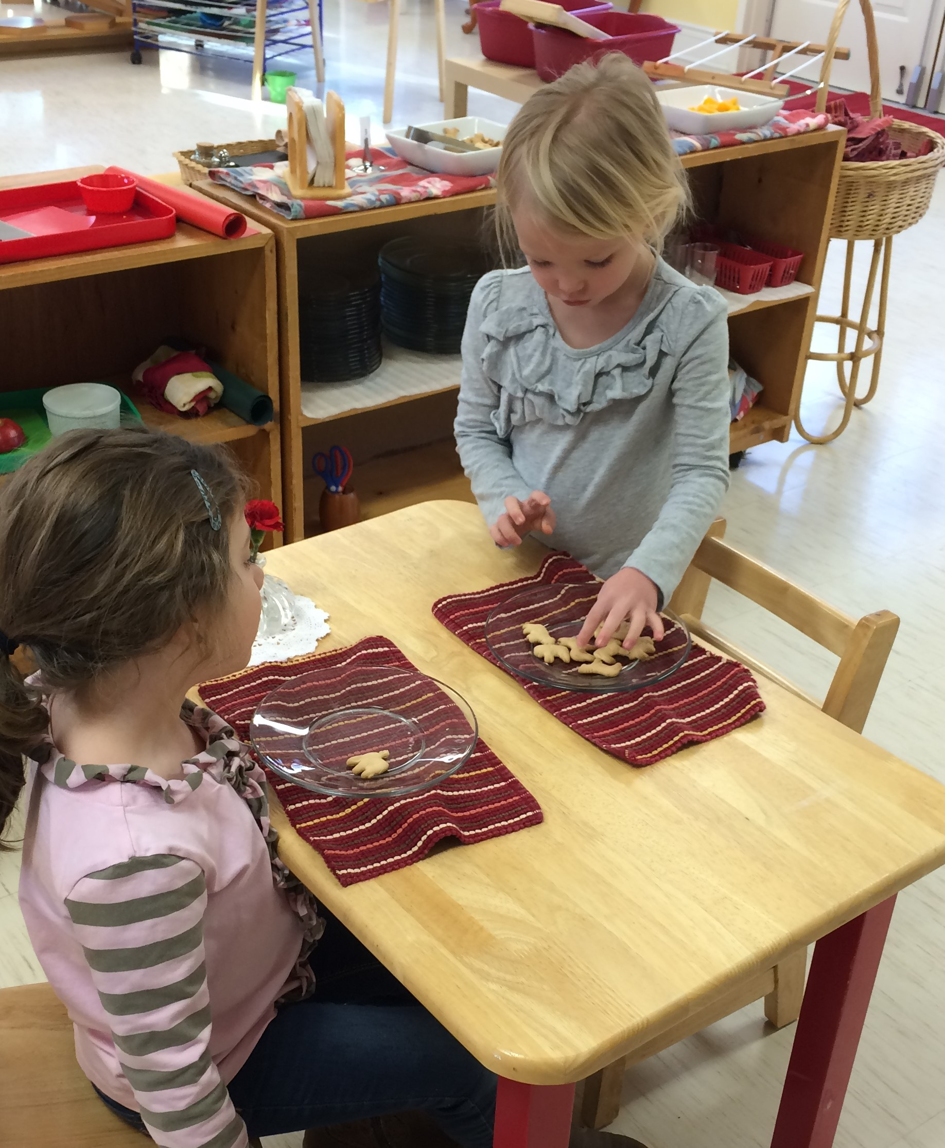 We cannot forget snack as it is an intricate part of the day. The children eat in pairs. Numbers are placed beside the snack allowing the children to help themselves to the allotted amount. The child is able to practice table manners and enjoy the company of their friend.