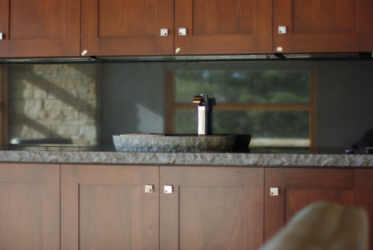 dining room bar with live edge granite countertop and vessel sink