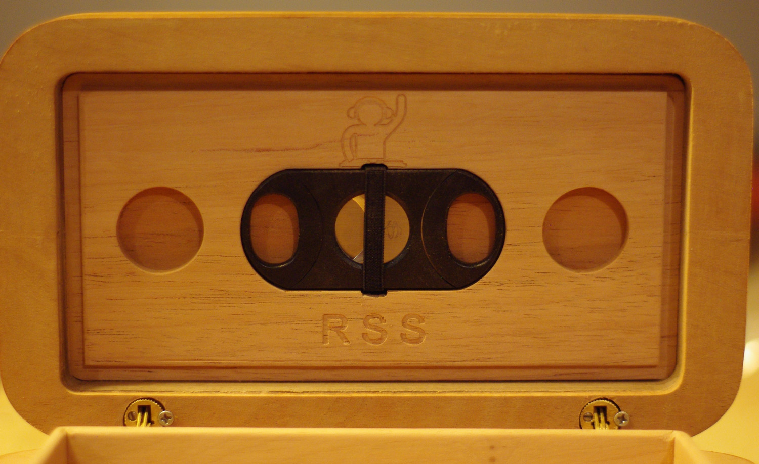 cigar cutter and humidifier recesses