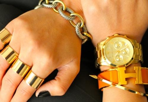 Hermes, David Yurman, Jules Smith bracelets, Michael Kors watch, Maison Martin Margiela rings