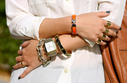 Hermes, House of Harlow and David Yurman bracelets, Michele watch, Maison Martin Margiela and Cartier rings