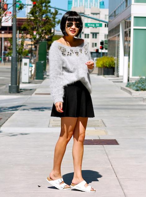 Club Monaco sweater and skirt, Birkenstock sandals, Ray-Ban sunglasses