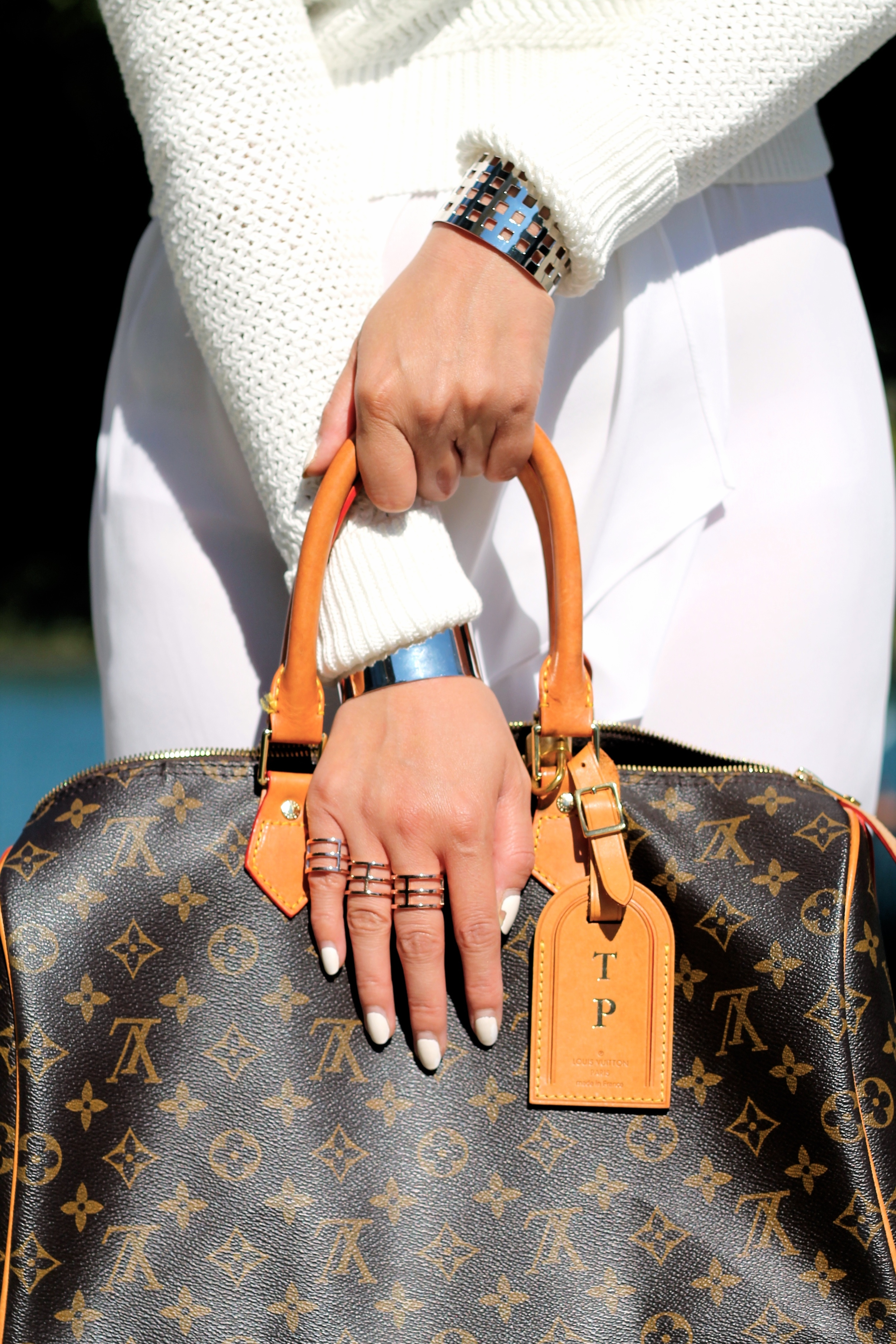 Svelte Metals  rings and cuffs, Louis Vuitton bag