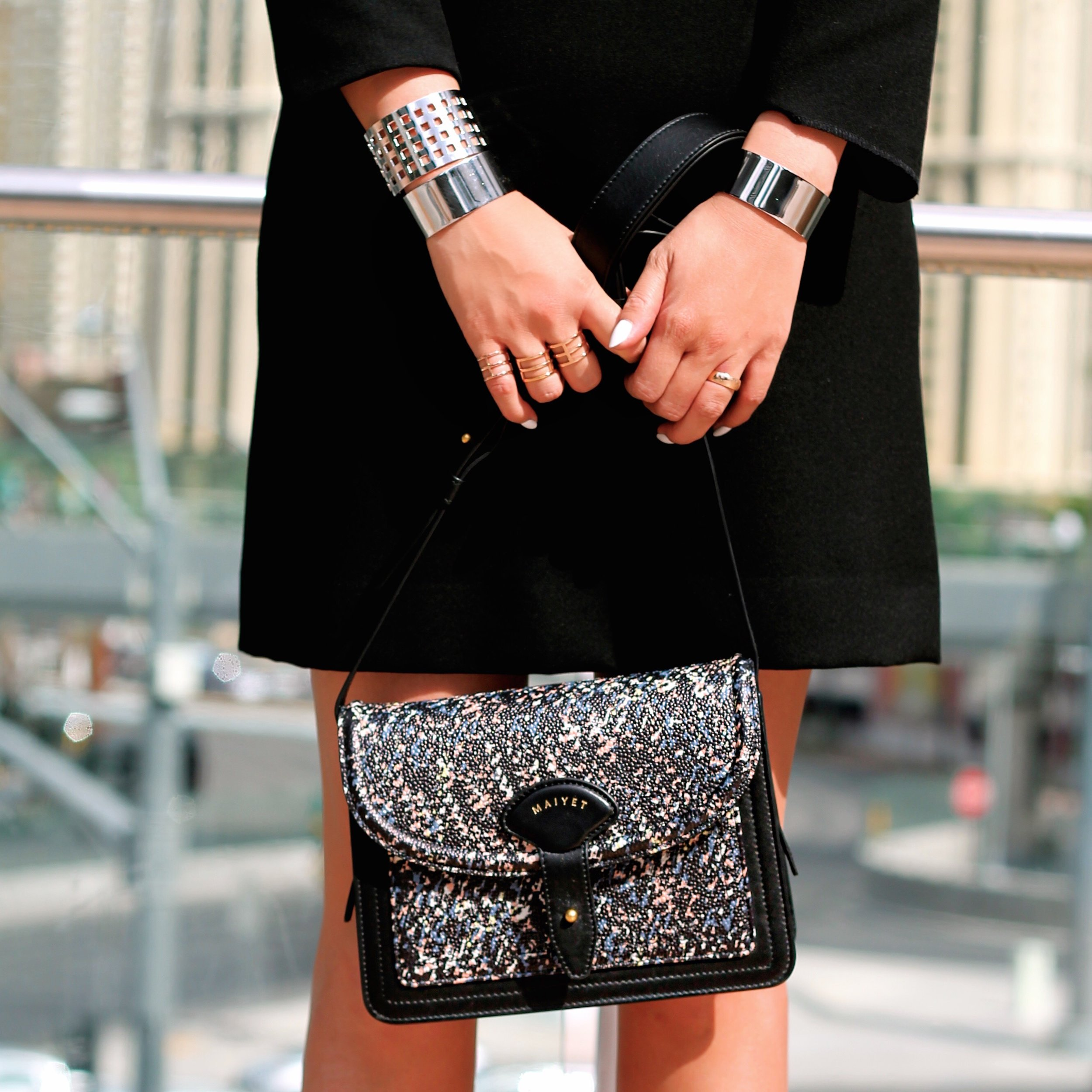 bag c/o Maiyet, Svelte Metals cuffs and rings