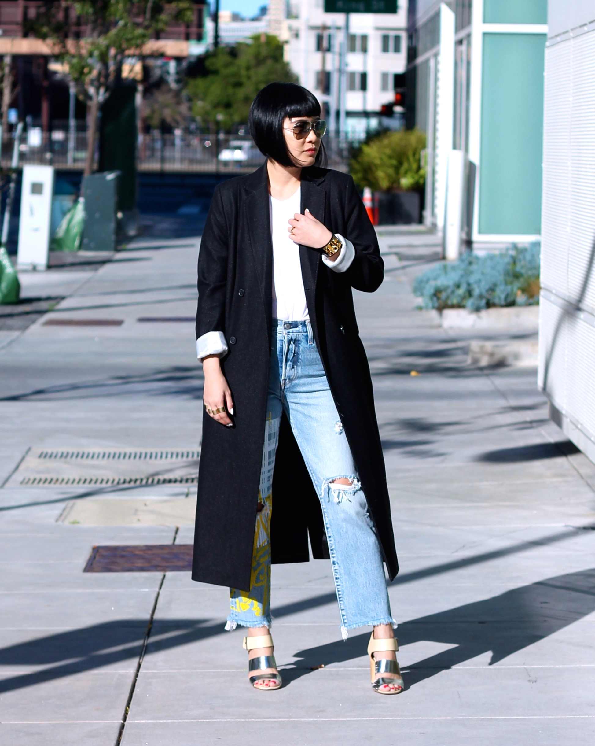 Hair c/o Sassoon Salon, Wilford Coat, tee c/o Cuyana, custom jeans c/o Levi's custom jeans, print by DVF, Sam Edelman shoes, Ray-Ban sunglasses, Hermes bracelet, Margiela rings