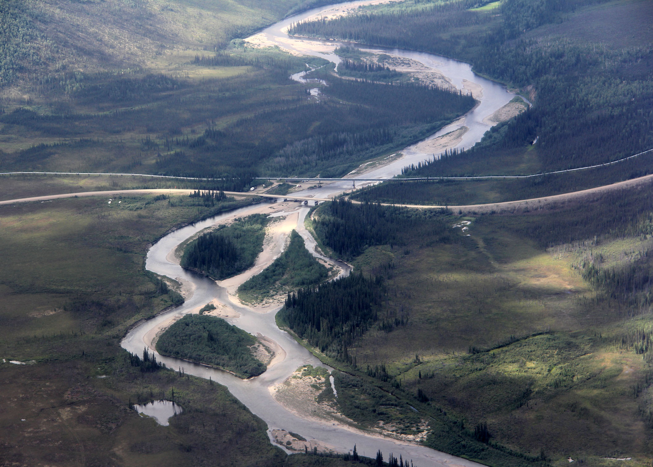 The intersection of the Dalton Highway, The Alaskan Pipeline and the Yukon River.