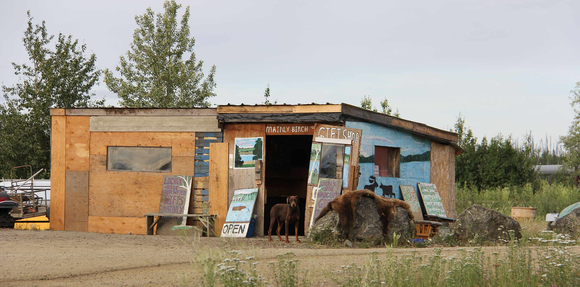 This gift shop sits alongside a bridge on the highway that goes over the Yukon River. The lady that runs it makes jewellery and sells it here. She lives with her husband up river in a house with no running water or electricity and takes a little boat each day to open her store.