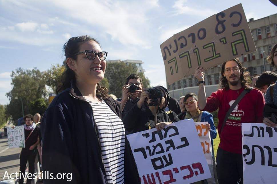 Conscientious objector Tair Kaminer is greeted by supporters outside the Tel Hashomer induction base, Ramat Gan, Israel, January 10, 2016. (photo: Oren Ziv/Activestills.org)