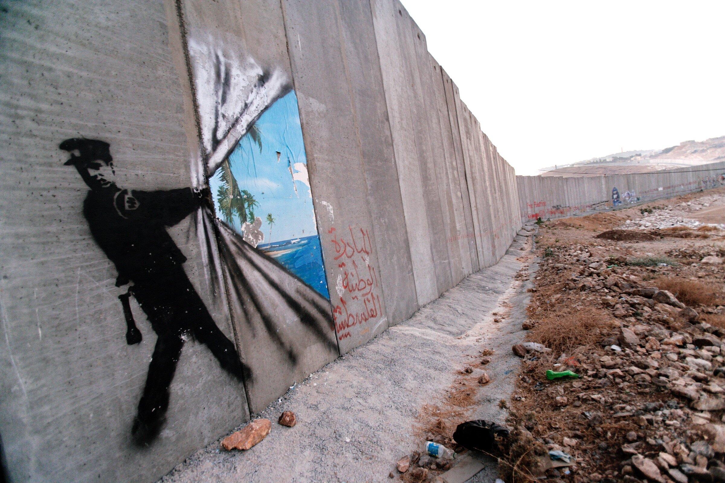 Fresque de Banksy sur le mur de séparation.   Centre international Olof Palme