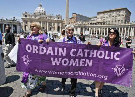 Representatives of the Women's Ordination Conference stage a protest in front of St. Peter's Basilica in Rome on Tuesday, June 8, 2010.    AP PHOTO/PIER PAOLO CITO