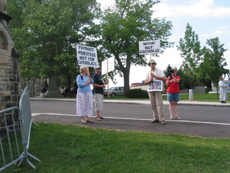 A handful of protestors make an appearance at the opening ceremony of  Women's Ordination Worldwide Second International Conference in Ottawa, July 22 - 24, 2005.