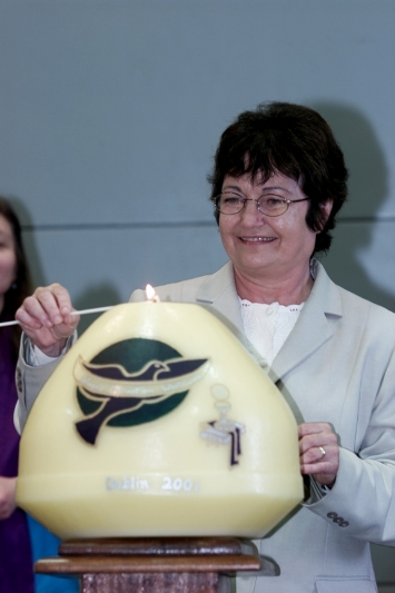 Nobel Peace Prize winner and keynote speaker, Mairead Corrigan Maguire lights the Women's Ordination Worldwide candle at the opening ceremony of WOW's First International Conference held in Dublin, Ireland in 2001.