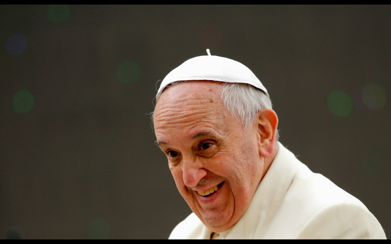Pope Francis smiles after leading his general audience in St. Peter's Square at the Vatican Feb. 26. (CNS/Reuters/Tony Gentile)