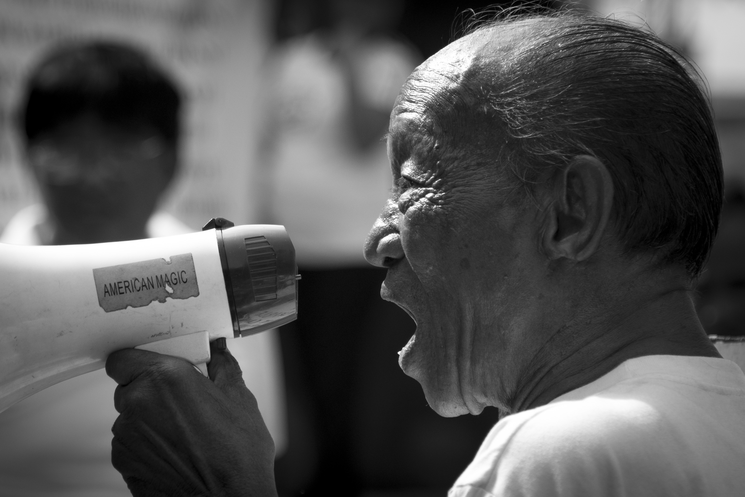 """On October 4th, Ayala Avenue was closed to traffic to allow the public to protest and criticise the government's """"Pork Barrel"""" Fund. Photojournalism is my first love, and to see this man speak while his grandchild stood by his side was overwhelming."""