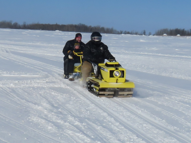 merle gives ride on husky.JPG