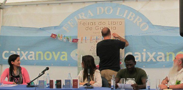 "Hanging the audience's sacrificed passports and ID cards on the ""voyagers' tightrope"". La Coruña Book Fair, Spain, August 2010. With Yolanda Castaño and   Ecodesarrollo Gaia Coruña Senegal ONG.   Photograph by Cristina López Rodríguez."