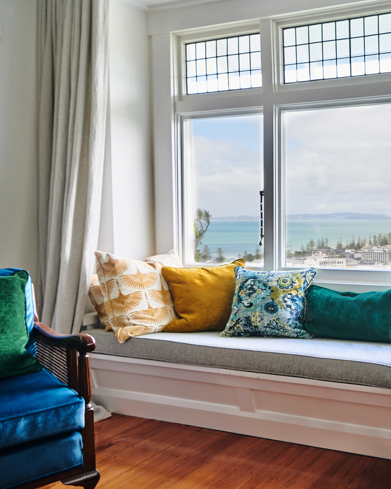 Marilyn's living room with views over Napier and out to Cape Kidnappers | photo:    Florence Charvin