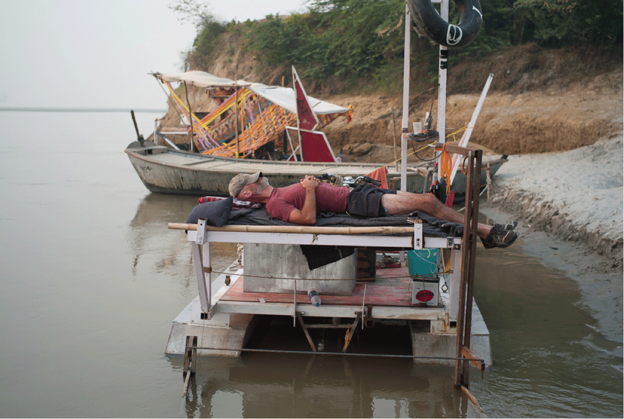 Me sleeping on the deck of the Mary O