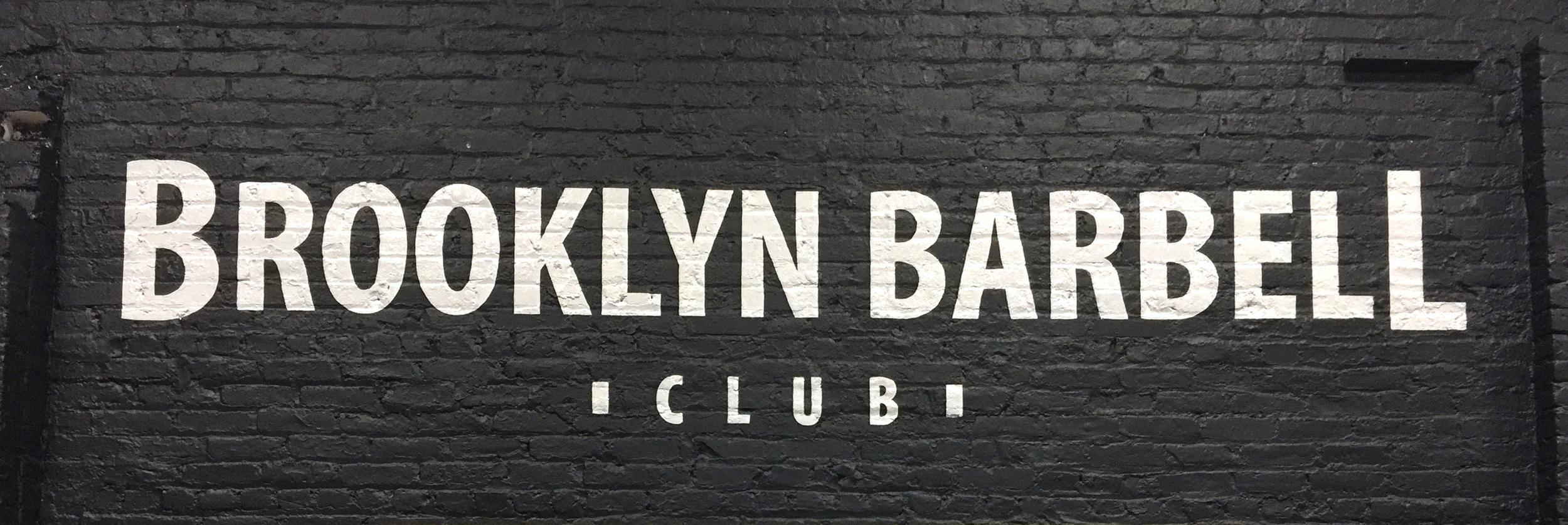 Sign on a brickinterior wall in Williamsburg, Brooklyn for  Brooklyn Barbell Club .