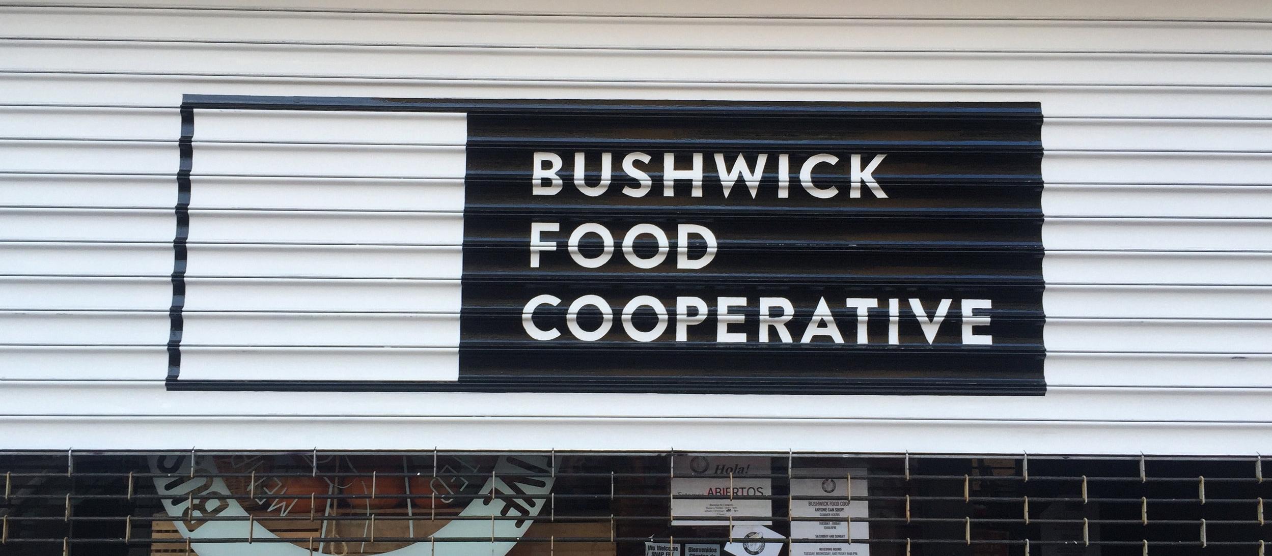 Logo on rollgate for  Bushwick Food Coop  in Bushwick, Brooklyn, NY.