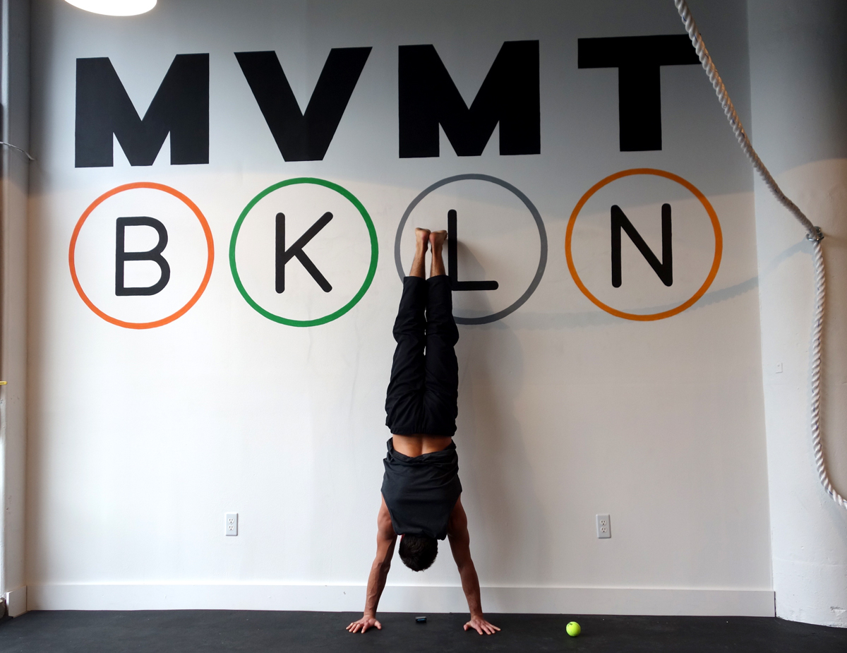 Hand painted logo on interior handstand wall for  Movement Brooklyn .
