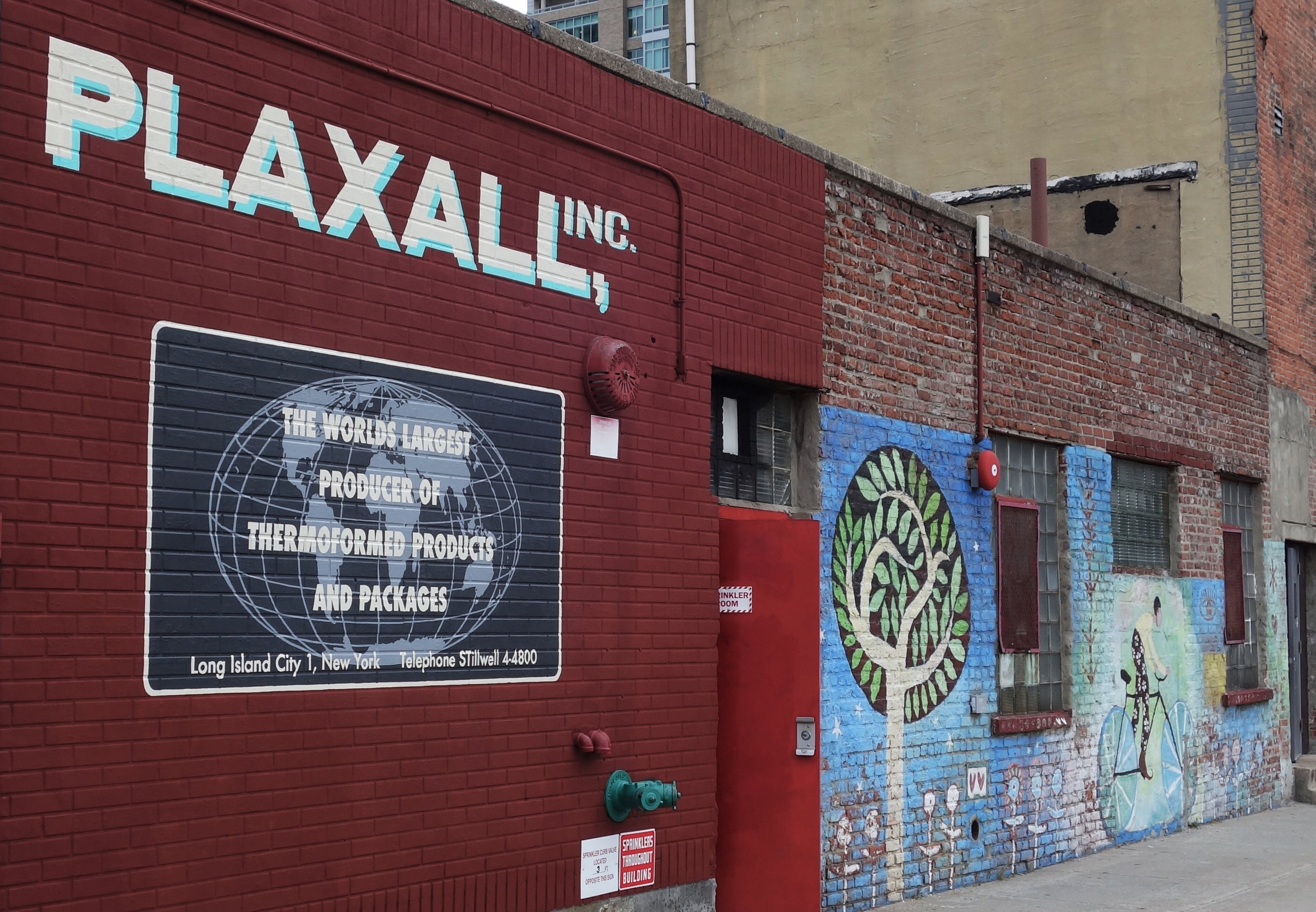A vintage look sign painted for  Plaxall, Inc  in Long Island City, NY.